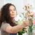 hermosa · concentrado · mujer · florista · de · trabajo · flores - foto stock © deandrobot