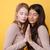 güzel · genç · iki · kadınlar · poz · sarı - stok fotoğraf © deandrobot