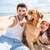 happy couple with dog taking a selfie at the beach stock photo © deandrobot