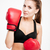 sports woman in boxing gloves looking at camera stock photo © deandrobot