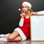 woman in santa costume with white board showing silence sign stock photo © deandrobot