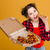 Beautiful happy young woman holding and eating pizza stock photo © deandrobot