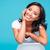 sorridente · asiático · mulher · mão · queixo · olhando - foto stock © deandrobot
