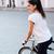 brunette · fiets · handen · ogen · natuur · groene - stockfoto © deandrobot