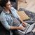 счастливым · человека · сидят · диване · джинсов - Сток-фото © deandrobot