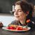 mulher · jovem · alimentação · peixe · tomates · imagem · bastante - foto stock © deandrobot