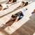 multiethnic group of people doing stretching exercises in yoga studio stock photo © deandrobot
