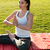 woman doing yoga exercises and meditating on lawn stock photo © deandrobot