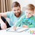 Happy little son and dad drawing with colorful markers  stock photo © deandrobot
