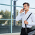 thoughtful young businessman talking on the phone outdoors stock photo © deandrobot
