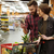 Happy loving couple in supermarket looking at mobile phone. stock photo © deandrobot