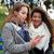 twee · glimlachend · vrouwen · luisteren · naar · muziek · smartphone - stockfoto © deandrobot
