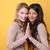 mutlu · genç · iki · kadınlar · ayakta · sarı - stok fotoğraf © deandrobot