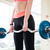 barbell holded by young sportswoman working out in gym stock photo © deandrobot