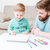Smiling dad and little son drawing with colorful markers  stock photo © deandrobot