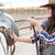 woman cowgirl standing and putting saddle on horse stock photo © deandrobot