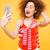 vertical image of bright model making selfie stock photo © deandrobot