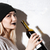 side view of hipster girl with bottle stock photo © deandrobot