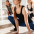 smiling beautiful young woman practicing yoga in group stock photo © deandrobot