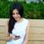 glimlachend · jonge · vrouw · vergadering · bank · buitenshuis · straat - stockfoto © deandrobot