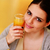 jonge · mooie · vrouw · oranje · glas · sinaasappelsap - stockfoto © deandrobot