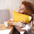 portrait of a lovely young red hair woman hugging pillow stock photo © deandrobot