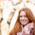 glimlachend · vrouw · naar · camera · buitenshuis - stockfoto © deandrobot