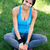happy fitness woman sitting on the green grass stock photo © deandrobot
