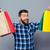 肖像 · 笑みを浮かべて · 男 · ショッピングバッグ · 服 · ストア - ストックフォト © deandrobot