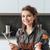 alegre · mulher · jovem · sessão · cozinha · alimentação · peixe - foto stock © deandrobot