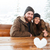 couple sitting outdoors with heart made of snow in winter stock photo © deandrobot