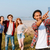 happy man standing and taking selfie with his friends outdoors stock photo © deandrobot