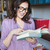 portrait of a smiling mature woman reading book stock photo © deandrobot