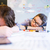 exhausted woman and man sleeping on table stock photo © deandrobot