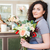 woman florist with bouquet of flowers standing in flower shop stock photo © deandrobot