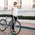 casual brunette woman cyclist standing near a bike stock photo © deandrobot