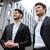 two businessmen standing near business center stock photo © deandrobot