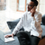attractive african businessman talking by phone coworking stock photo © deandrobot