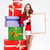 cheerful woman in santa claus cloth holding blank board stock photo © deandrobot