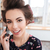 cheerful woman in curlers talking on mobile phone stock photo © deandrobot