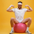 smiling sportsman sitting on fitness ball and showing biceps stock photo © deandrobot