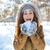woman holding snow in winter park stock photo © deandrobot