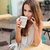 smiling beautiful woman drinking coffee and talking on cell phone stock photo © deandrobot