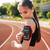 close up portrait of a female runner using mobile phone stock photo © deandrobot