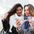 two happy young girlfriends looking on a smartphone outdoors stock photo © deandrobot