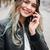 glimlachend · jonge · kaukasisch · vrouw · lopen · buitenshuis - stockfoto © deandrobot