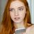 pensive woman holding smartphone stock photo © deandrobot