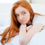 pensive redhead woman lying on the bed stock photo © deandrobot