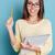 gülen · genç · kadın · işaret · yukarı · bakıyor - stok fotoğraf © deandrobot