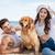 szczęśliwą · rodzinę · gry · psa · plaży · szczęśliwy · młodych - zdjęcia stock © deandrobot